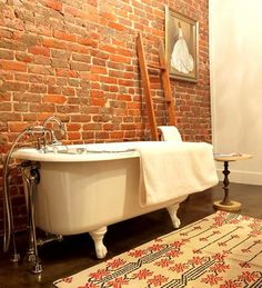 exposed brick bathroom with clawfoot tub Faux Brick Panels, Brick Paneling, Exposed Brick Walls, Brick Tiles, Brick Bathroom, Bathroom Ideas, Bathroom Wall, White Bathroom, Bathroom Cabinets
