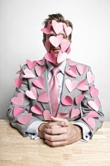 Businessman Office Worker Covered in Sticky Note Pink Hearts stock photo