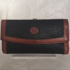 Dooney and Bourke .  Vintage Wallet Pebbles black British tan trim tri fold leather wallet removable checkbook carrier in excellent pre owned condition , smoke and           pet free environment. Dooney & Bourke Other
