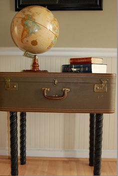 Think of this for all those old suitcases in the attic! Re-purposed Vintage Suitcase Table