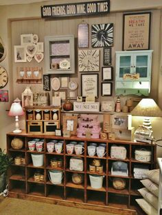 Shop Interior - La Maison Items Hung/displayed then stored underneath..good use of space & effective display