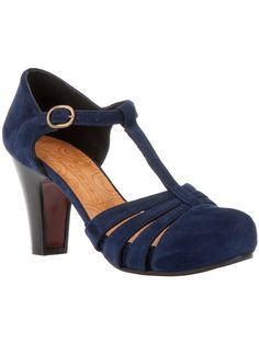 Blue suede pump from Chie Mihara featuring a round toe, cut-out detailing at the front, a leather sole, a tapered wooden heel, and a t-bar strap with a gold-tone buckle fastening at the ankle.