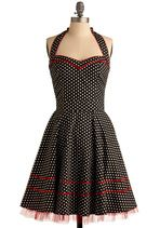 black and white polka dot dress with red trim and tulle