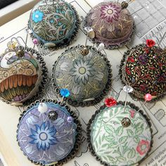 pincushion brooches.  The one on the left that looks like a smiling monster with rows of teeth.