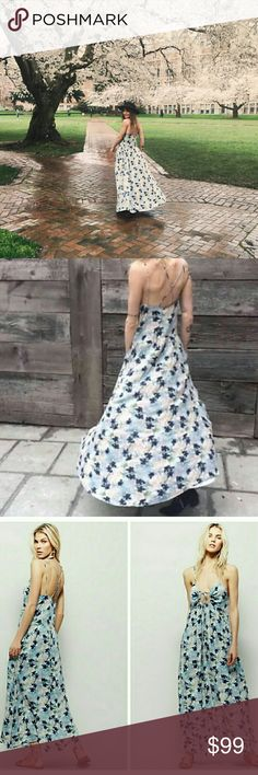 Free People Floral Spring Dress NWOT Floral printed maxi dress in a flowy fit with a crisscross strappy back. Keyhole opening in back with adjustable tie. Hip pockets. Lined.  100% Rayon Machine Wash Cold Import Free People Dresses Maxi