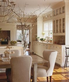 I love the idea of the large window over the sink and the extended counter. And the light color of the cabinets.