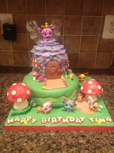 My niece wanted a LPS cake, and loves the new fairies.  I used a fairy cake from Bella Cupcakes (New Zealand) and tweaked it to suit my needs and supplies (and skill).  Im still learning, this is cake # 7 for me using fondant.  Figures are from the store, LPS toys.