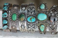 Stack of Fred Harvey era Indian bracelets. 1930's.