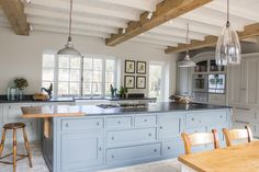 Mark Taylor Design Ltd. Recently completed bespoke kitchen. Transitional style inspired by a French country kitchen.