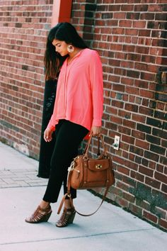 big earrings, pink silky blouse, black pants, brown wedges, brown Target purse