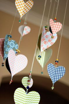 What a lovely use for scrap paper and odd beads. They are wonderful hanging where a breeze moves them.  Snowflake shapes??