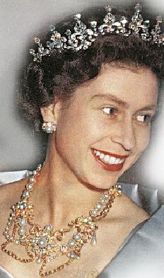 Queen Elizabeth II wearing Queen Alexandra's Dagmar Necklace (without the cross), the Girls of Great Britain and Ireland tiara (without diamond base) and Queen Alexandra's wedding earrings.
