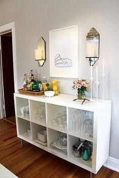 Add legs a shelf to make buffet table - GREAT IDEA! Put in some baskets or maybe a curtain over a few! love it