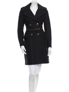 Navy Burberry wool coat with notched collar, dual flap pockets at hip, gold-tone zip accent at waist and double-breasted button closures at center front.