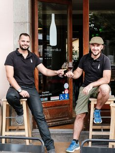 The sommelier and the chef, owners and great friends, sharing a glass of wine on the steps of their passion project and wine bar. Wine Bars, Passion Project, Great Friends, Geneva, Glass, Style, Bottle, Swag, Drinkware