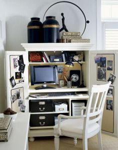 For a functional and easily concealable work space, use an armoire. Pick one specifically designed for computer equipment, or customize a regular armoire with shelves and cubbies to suit your needs. When guests come by, simply close the doors to hide the clutter.