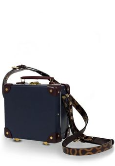 Vivienne Westwood Loves Mini Utility Case has been designed in midnight blue with burgundy leather corner/trim detail and polished brass hardware. The interior, Westwood's signature blue tartan, mirrors the Vivienne Westwood Loves Cashmere Shawl. Finished with luggage belts which feature Westwood's iconic Squiggle print, as first appeared in the Autumn/Winter 1981 Pirate collection in chestnut brown/bronze.