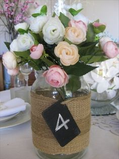 What to do with a large coffee Jar - Just add String a few flowers real or fake. You can tie a mini blackboard label as a table number.