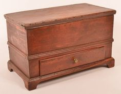 """Pennsylvania Early Miniature Blanket Chest. : Lot 534 Pennsylvania Early 19th Century Miniature Blanket Chest. Original red painted surface with molded lid, interior till, wrought iron strap hinges, dovetailed case, molded trim, single dovetailed drawer and molded bracket base. 13""""h. x 20-1/2""""w. x 11"""" d. Condition: Good, restoration to molding, drawer front and bracket base. sliver of wood missing from drawer. Harry Hartman Sold $500"""