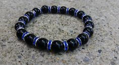 Check out this item in my Etsy shop https://www.etsy.com/listing/453950978/thin-blue-line-bracelet-support-law