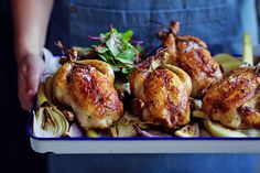Roasted spatchcocks with brioche stuffing. This one-tray roast is guaranteed to please the family (and the one doing the washing up too). If you've not had much experience with spatchcocks before, just think of them as little individual sized chickens. A Food, Good Food, Yummy Food, Fathers Day Lunch, Quick Weeknight Meals, Sunday Roast, Stuffing Recipes, Roast Chicken, Serving Platters
