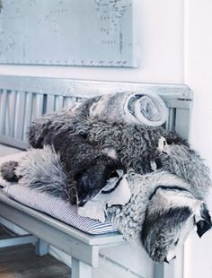 Luxurious. Home and Delicious blog brings this post for our delight! I believe you can find wolf-like fur throws at Pottery Barn.