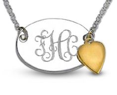 "Trendy Personalized oval sterling silver disk measures 1"" across. A 14kt. gold heart dangles fr"