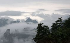 """Tianzi Mountain (天子山): Tianzi is close to the Suoxi Valley. It is named after the farmer Xiang Dakun of the Tujia ethnic group, who led a successful local farmers' revolt and called himself """"Tianzi"""". This means """"Son of Heaven"""" and is the traditional epithet of the Chinese Emperor. The later generation named the places where Xiang Dalun had fought """"The Son of Heaven"""" in memory of his contributions."""