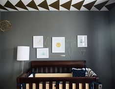Baby Jack is already setting nursery trends in his blue and gold nursery! We're loving the geometric patterns and shapes that are so so hip!