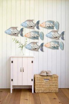 Fish for the wall. Iron fish sculptures: http://www.ironfishart.com/shop/all-coastal-sculptures.html