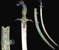 Indo-Persian shamshir (sabre),  curved watered-steel blade, silver-gilt hilt with the pommel and quillons each in the form of a ram's head, densely decorated in champlevé translucent and opaque enamels with floral panels delineated by bands with fish or duck against a green background,  Profusely decorated with colourful enamel work, 95cm. signed: KALB 'ALI, PERSIA, dated: 1081 AH/1670 AD..