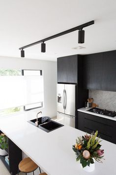 Black track ceiling mount light in the kitchen. Black kitchen with modern style, featuring marble splashback and polished concrete floors light Gina's home: new black track ceiling mount light in the kitchen - STYLE CURATOR Modern Track Lighting, Modern Kitchen Lighting, Modern Kitchen Interiors, Kitchen Lighting Fixtures, Modern Farmhouse Kitchens, Black Kitchens, Rustic Kitchen, Kitchen Track Lighting, Kitchen Black