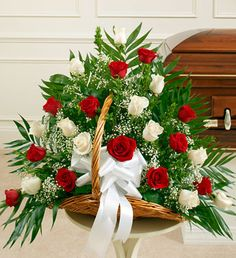 Red and White Rose Fireside Basket - Send Fresh Flowers Internationally   Send a message of sympathy, love and hope with this basket of white roses.