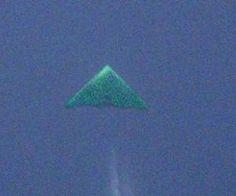 Photographer Captures Mysterious Triangular Flying Object (Photos)