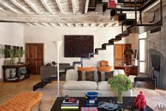 The Rome living room of interior designer Livia Rebecchini and her family. Her apartment occupies the top two floors of a 16th-century palace.