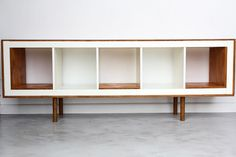 Ex Ikea upright Expedit hacked into mid century modern sideboards! Turn the bookcase on its side, we had 12mm ply board that we cut to size.