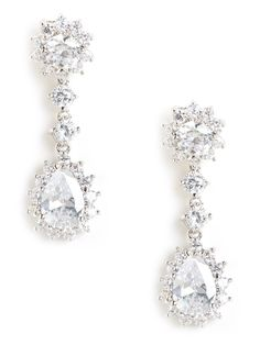 Channel your inner princess in these dazzling drop earrings, which feature a glorious cascade of faceted diamond-like gems. Even better: Some of those crystals are framed by more glittering finery.
