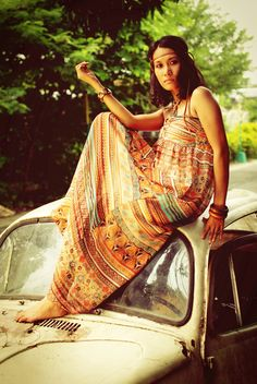 boho chic by erick4u photography.  This could almost be a picture from the sixties.  The thong around the head, the old VW bug, the bare feet and the print of the loose gypsy dress.