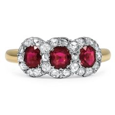 The Apple Ring from Brilliant Earth--I love this, it is very similar to my mom's 3 stone ruby ring.  Hers doesn't have the diamonds but it reminds me of her ring.  *Trisha