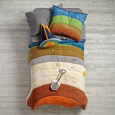 Are you kidding me? Cross section of the earth bedding? volcano pillow!?? this. rocks.  Land of Nod - To the Center of the Bedding