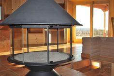 Round Indoor Fireplace   360 degree glass fireplace in center of Great Room