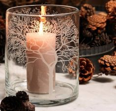 Etched tree on glass candle holder.