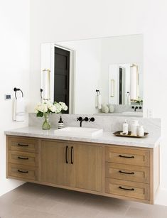 Acorn Woodworking crafted the master bath's vanity, which features a Duravit sink and fittings.