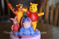 Winnie the Pooh and Friends 1st birthday cake. Pastel pink with purple polka dots! {Nina's cake and Bake Shoppe} on Facebook and Instagram!!