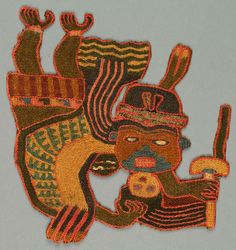 """Flying or floating masked human figure holding a wand or a fan and a trophy head. Embroidered in strong colors.    This fragment is medium: wool technique: stem stitch on plain weave.    This fragment is from Peru and dated """"300–100 BC""""."""