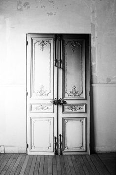 """""""Trompe-l'œil"""" doors: A """"typically haussmannian"""" door is printed life size on adhesive fabric that can be repositioned several times.  Dimensions: 225cm x 120cm.  Made in France."""