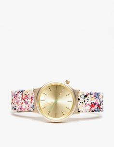 cool watch with patterned band and gold face