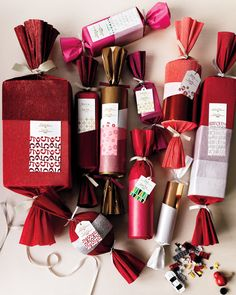 "Here's an excellent speedy (and easy) way to wrap almost anything: Place gifts in empty cereal or shoe boxes, tuck them into paper-towel or toilet-paper rolls, or ditch the boxes altogether and just cover them with crepe paper, as we did with the ball and wine bottle here (we'll give you two guesses). Finish the packages with wrapping paper or tissue, and tie them off with ribbon. Our clip-art tags give them another graphic layer. Florist crepe paper, 20"" by 8', in Red Velvet, Red, and ..."