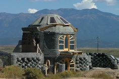 """Earthship Home by Larry Myhre, via Flickr. """"nteresting house in the """"sustainable"""" village of Earthship, several miles northwest of Taos, New Mexico. With homes built of recycled materials, the walls of this house are made of old tires and aluminum cans."""""""