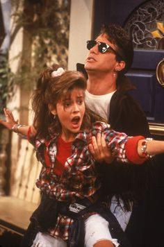 """Alyssa Milano (Samantha) is sporting the essential 90s hair accessory, the scrunchi and Tony Danza (Tony) has a handsome hair cut on """"Who's The Boss?"""""""